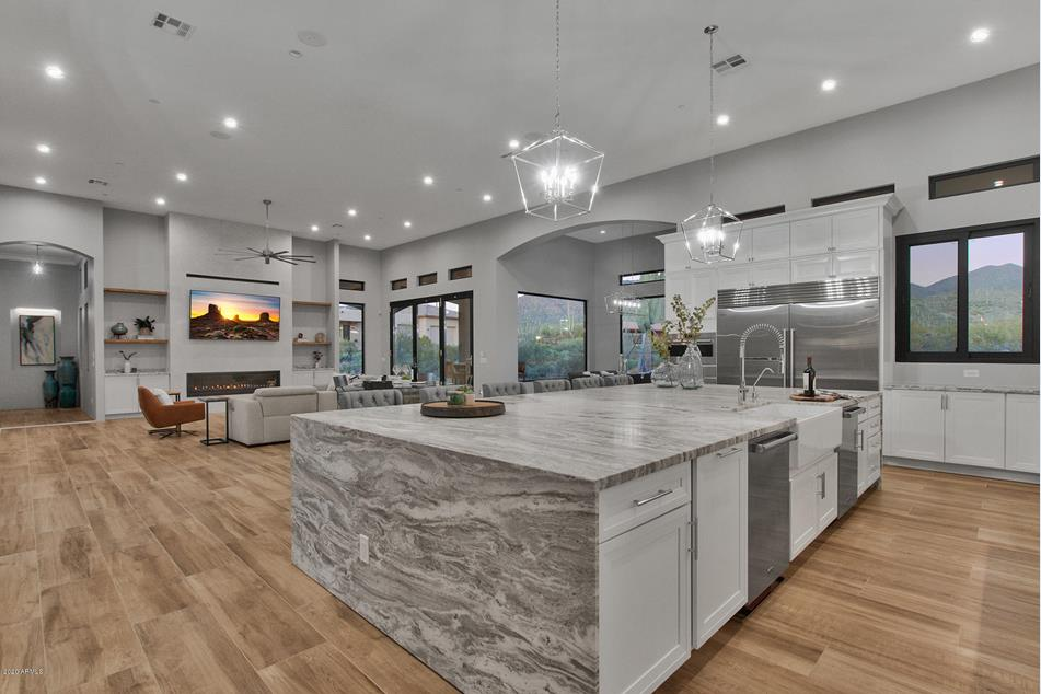 Enclosed Courtyard Custom Home with 6 Bedrooms, 6 Bathrooms and 5 Car Garage located in Cave Creek AZ